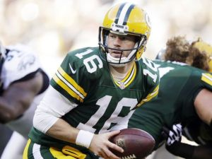 Green Bay Packers quarterback Scott Tolzien takes a snap during the first half of an NFL football game against the Philadelphia Eagles Sunday, Nov. 10, 2013, in Green Bay, Wis. Tolzien replaced an injured Seneca Wallace. (AP Photo/Tom Lynn)